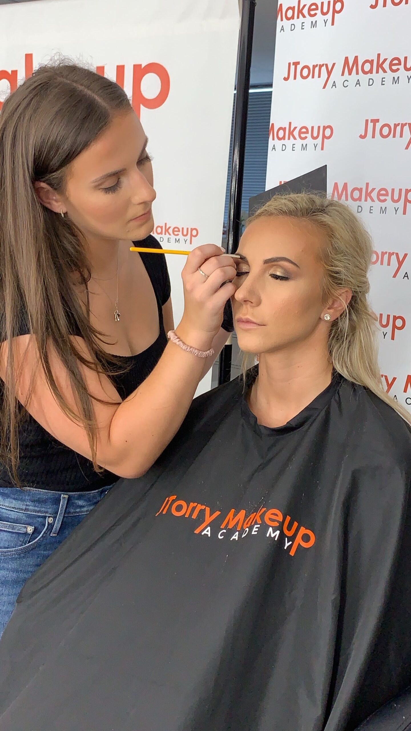 Student doing makeup